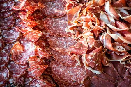 Salami and ham picked from above, cut and finely laid, buffet for party wedding and dinner