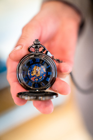 The pocket watch in noble blue, is held in the hand Stock Photo