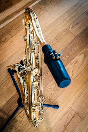 the saxophone stands and is played in gold