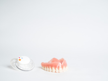 A picture of dummy and bit, baby pacifier, facing tooth health