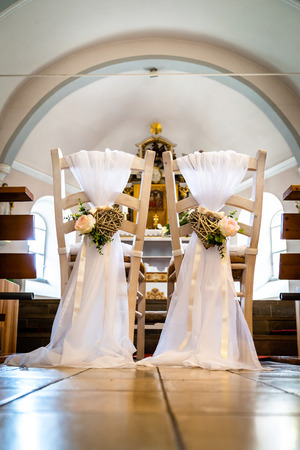 The chairs for a wedding in the church