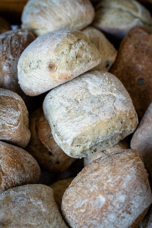 A combination of rolls with a variety of seeds, sprinkled with flour, bakery, modern photography Archivio Fotografico