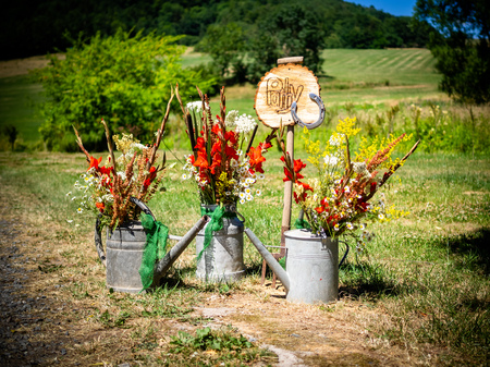 the sign for the party with flowers and watering can in summer and spring autumn Archivio Fotografico