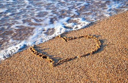 heart in sand: Heart on the beach Stock Photo