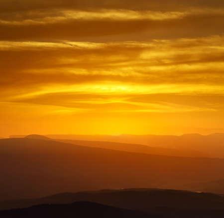 quiet scenery: Hills during sundown Stock Photo