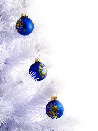 Decorative toys on the white tree  Abstract background