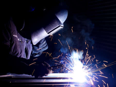 welding worker: Welding and bright sparks  Construction and manufacturing