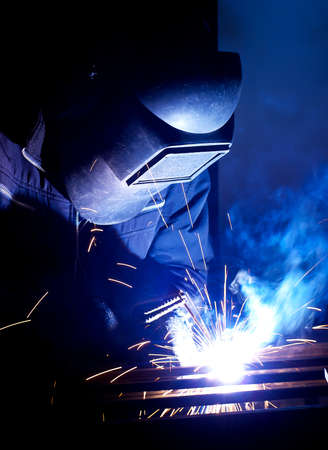 Welder on the workplace  Construction and manufacturing Foto de archivo