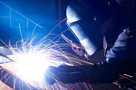 Welder on the workplace  Construction and manufacturing Stock Photo