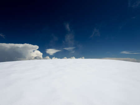 Snow plain and dark sky  Beautiful landscape photo