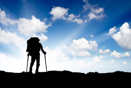 Silhouette of a tourist in the mountains  Sport and active life photo
