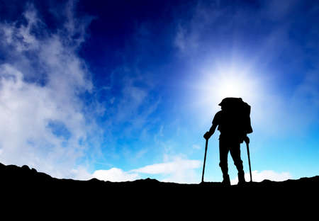 Silhouette of a tourist in the mountains  Sport and active life