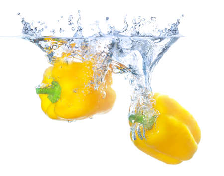 falling water: Juicy pepper and water splash Stock Photo