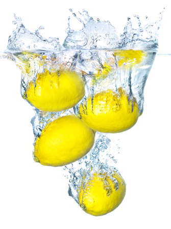 Juicy lemons and water splash photo
