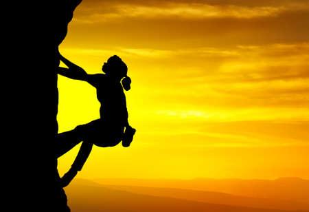 Rock climber on background of sundown  Sport and active life Banco de Imagens