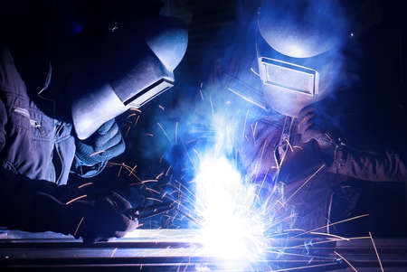 Welder on the industrial workplace