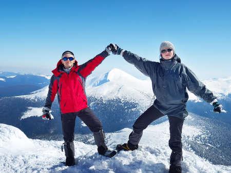 Tourist team on peak of mountains  photo