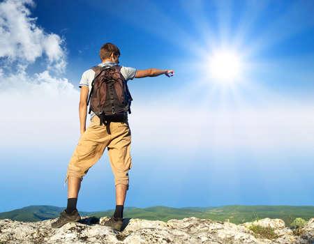 Tourist on peak of mountain  Active life concept Banco de Imagens