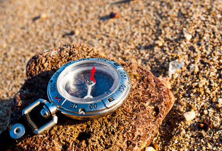 compass on the rock photo