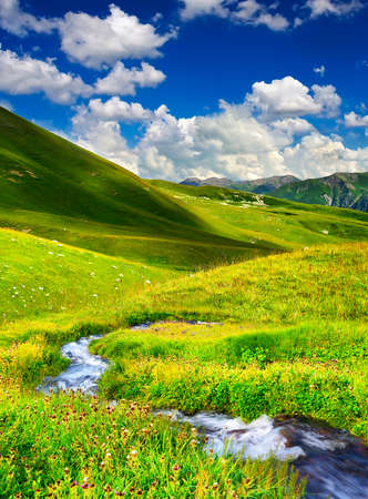 amongst: River on meadow amongst mountain valley