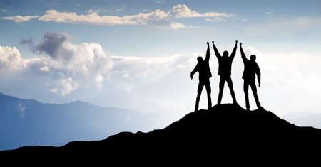 Silhouette of sport team on mountain top Banco de Imagens - 28393048