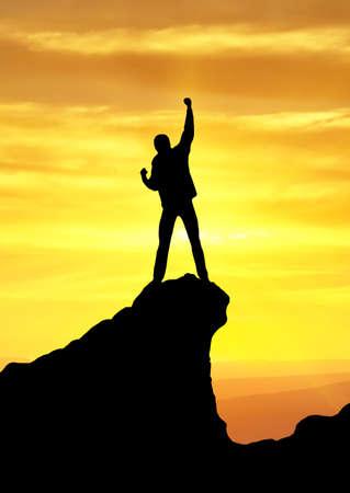 mountain climber: Silhouette of champion on mountain peak