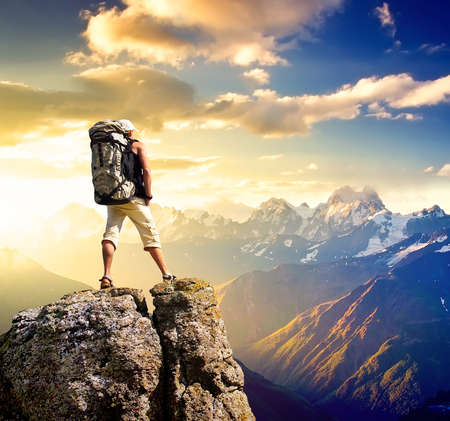 mountains and sky: Tourist on the mountain peak Stock Photo