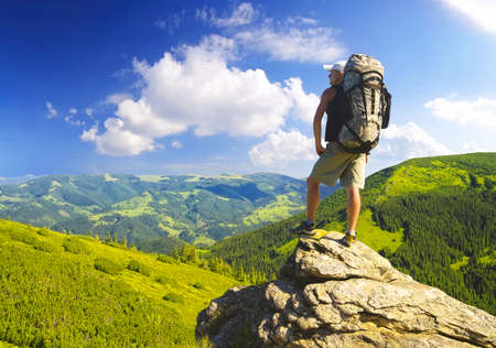 mountain peak: Tourist on the rock. Sport and active life concept Stock Photo