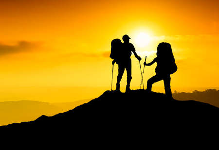 Tourist team on the mountain top. Sport and active life concept photo