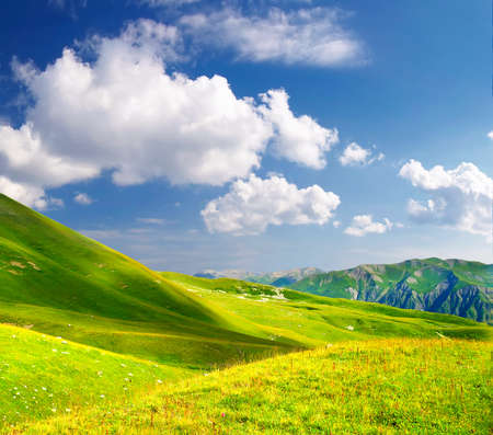 cloude: Field and cloude sky in the mountain valley. Beautiful summer landscape