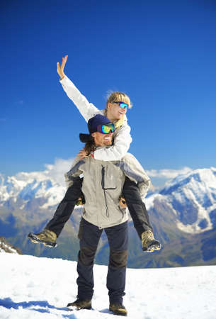 Happy couple on the snowy top. Sport and active life concept photo