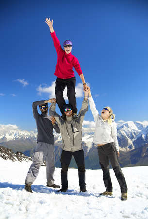 Team on the snowy mountain top. Sport and active life concept photo