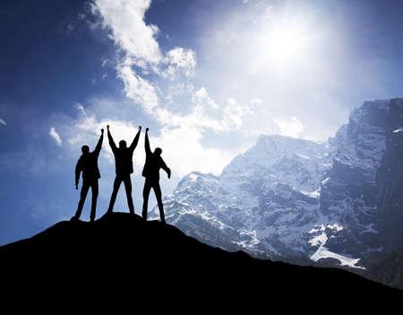 Team on mountain top. Active life concept photo