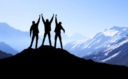 team sports: Silhouette of team in mountains. Sport and active life concept