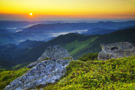 fall landscape: Grass and stone on the mountain hill during sundown. Beautiful summer landscape Stock Photo