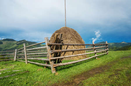 Stack of hay on field. Agricuktural landscape photo