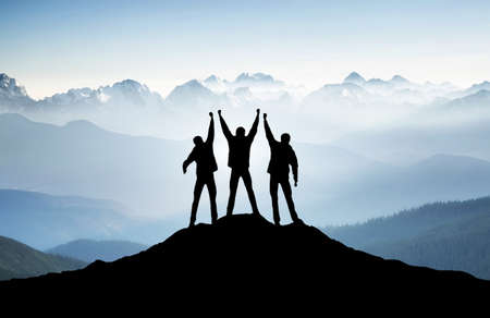 Team on mountain top. Active life concept Stock Photo - 38566282