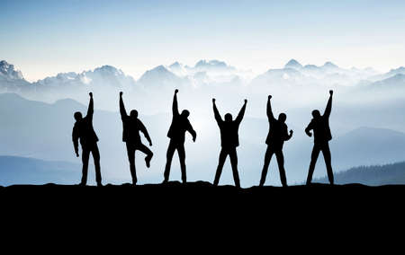 Team on mountain top. Active life concept