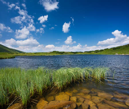 water  scenic: Lake in mountain valley. Beautiful natural landscape