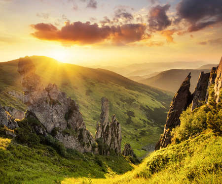 sunrise mountain: Mountain valley during sunrise. Natural summer landscape