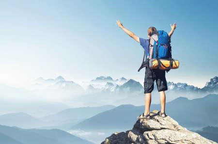 trekking: Tourist on mountain peak. Sport and active life concept
