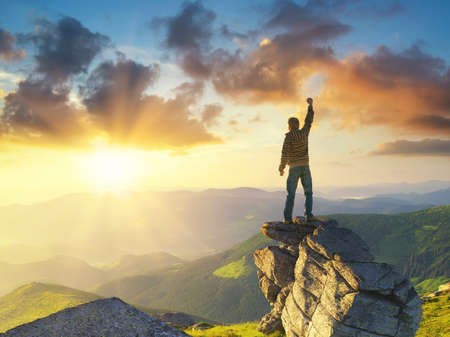 Silhouette of a champion on mountain peak. Active life concept 스톡 콘텐츠