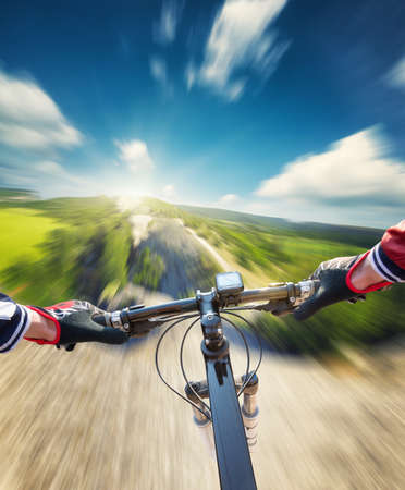 forest trail: Fast ride on mountain rocks. Sport and active life concept