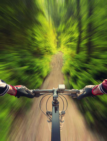 Fast ride in summer forest. Sport and active life concept