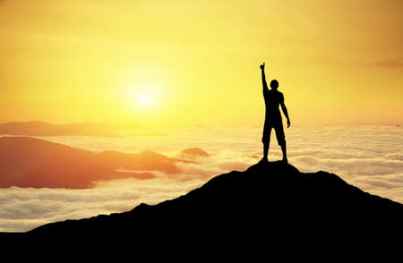 hiking: Winner silhouette on the mountain top. Sport and active life concept Stock Photo