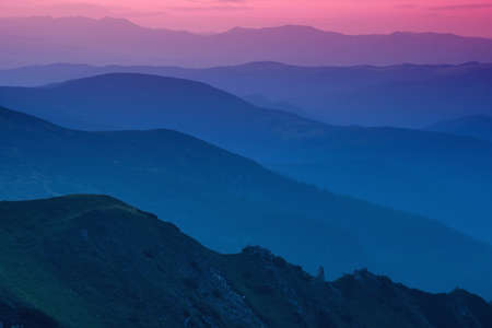 Hills lines in mountain valley during sunset. Natural summer mountain landscape Foto de archivo