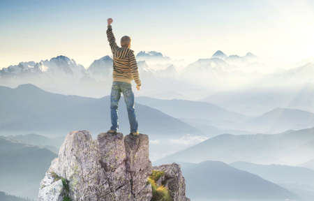 success man: Winner on the mountain top. Sport and active life concept