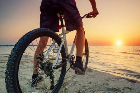 mountain man: Ride on bike on the beach. Sport and active life concept Stock Photo