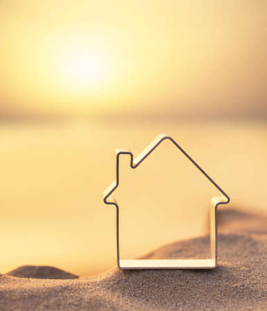 House on beach during sunset. Concept and idea