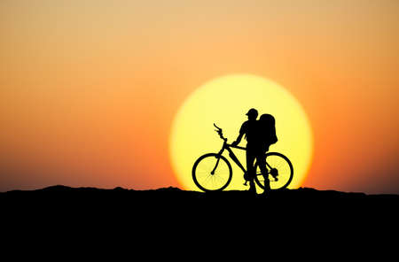 mountainbike: Silhouette of a biker on the mountain top. Sport and active life concept Stock Photo